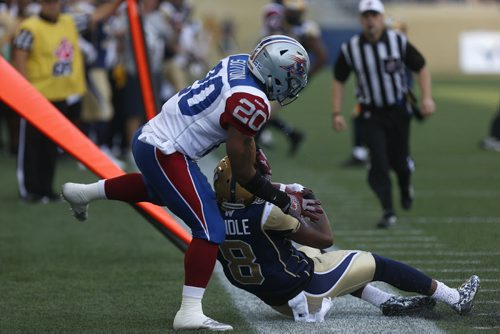 Winnipeg Blue Bomber #8 Chris Randle intercepts the ball from Montreal Alouettes #20 Tyrell Sutton during the first few minutes of the game at the Stadium Saturday.  July 10, 2015 Ruth Bonneville / Winnipeg Free Press