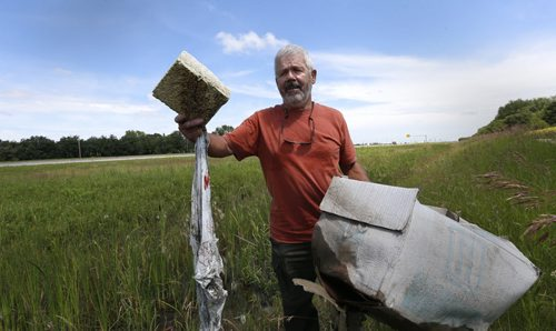 Bill Fisher, along the Perimeter Highway near Brady Rd. with some of the items in the ditch. He lives nearby. Gord Sinclair story. Wayne Glowacki / Winnipeg Free Press July 13 2015