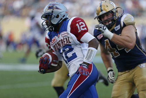 Montreal Alouettes  QB #12 Rakeem Cato runs with the ball  during the first half of the game at the Stadium Saturday.  July 10, 2015 Ruth Bonneville / Winnipeg Free Press