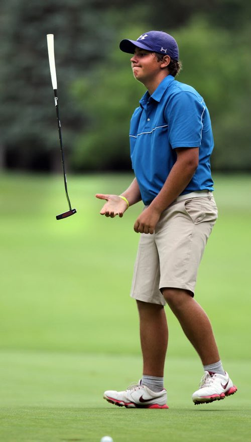 Marco Trstenjak tosses his putter after rimming the cup in one of several putts on the 18th tee at Elmhurst CC. Wesley Hoydalo took the lead and kept it from the 17th green in the Men's Junior Championship. See Tim Campbell's story. July 16, 2015 - (Phil Hossack / Winnipeg Free Press)