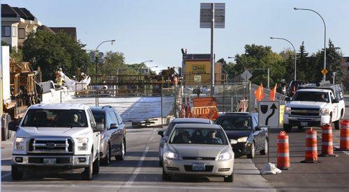 Tuesday morning traffic travels down Sturgeon Rd. to Portage Ave. around the bridge span under construction over Sturgeon Creek.   Wayne Glowacki / Winnipeg Free Press August 18 2015