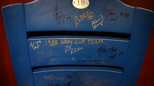 A seat from Canad Inns Stadium signed by the 1988 Grey Cup winning Blue Bombers on the shelf in Riley's Nebraska office. August 20, 2015 - Melissa Tait / Winnipeg Free Press