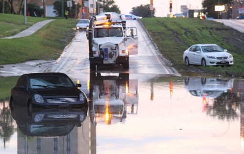 City crews try to figure out how to drain the Keewatin underpass after it filled with water from Friday's storm- Breaking News- Sept 04, 2015   (JOE BRYKSA / WINNIPEG FREE PRESS)