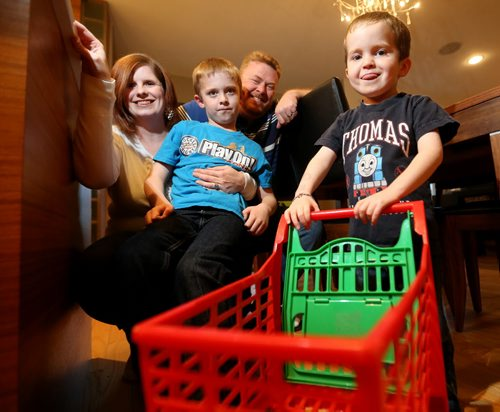 Liz, Will, 7, Kent and Max Bannister, 4. Max has been chosen by Starlight Canada , a charity that helps sick kids, to run through Toys'R'Us to get free toys, Monday, October 26, 2015. (TREVOR HAGAN/WINNIPEG FREE PRESS)