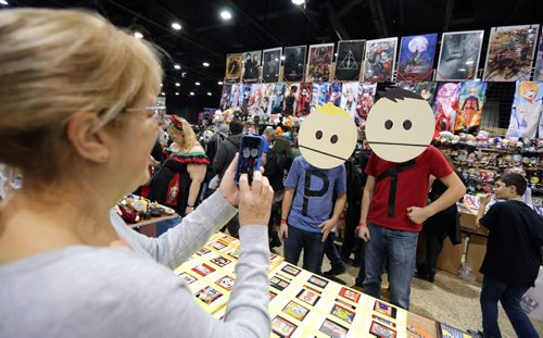 Marcia Kroeker of Bit By Bit Designs snaps a photo of Jarred Voth  (left) and Kris Orlow as characters Phillip and Terrance from South Park at Central Canada Comic Con at RBC Convention Centre Winnipeg on Oct. 31, 2015. Photo by Jason Halstead/Winnipeg Free Press