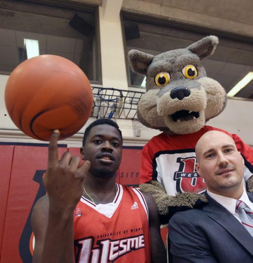 Winnipeg Wesmen star guard Denzel Lynch-Blair, left, with head coach Mike Raimbault and Wesmen Mascot Wes-Lee Coyote to promote upcoming  49th annual Wesmen Classic Basketball tournament- See Melissa Martin Story–Dec 07, 2015   (JOE BRYKSA / WINNIPEG FREE PRESS)