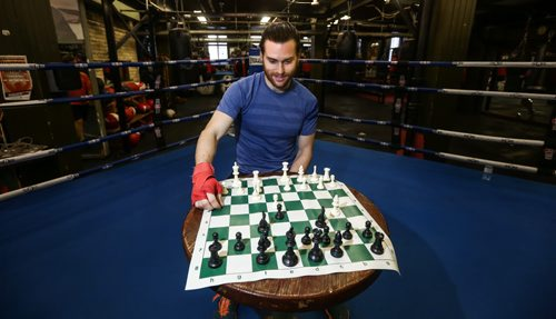 Sean Mooney is a former Winnipegger now working as a banker in New York.  He's also a chess boxer. A chess boxing match involves about five rounds of boxing and in between, you sit on your stool in the middle of the ring and play chess. You lose if you either get knocked out or your king gets taken. Reporter Geoff Kirbyson sparred with Sean Mooney in a couple rounds of chess boxing at Pan Am Boxing Club. 151228 - Monday, December 28, 2015 -  MIKE DEAL / WINNIPEG FREE PRESS