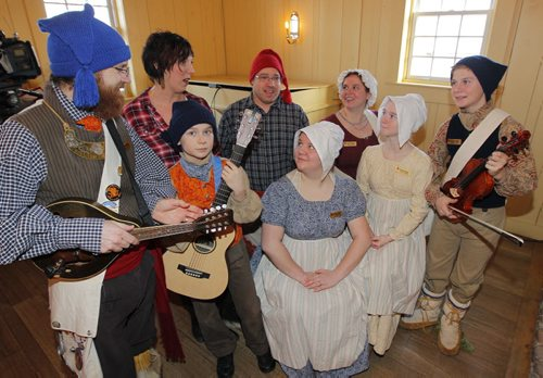 Press conference revealing the programming for the 47th edition of the Festival du Voyageur. La famille Sorin with Festival exec launch the event at  Great Hall, Maison du Bourgeois, Fort Gibraltar.  L-R (with blue hat) Marcel Sorin,  (behind in plaid) Ginette Lavack Walters, Executive Director, Cabrel Sorin (holding guitar), (behind with red hat) vice press of Festival du Voyageur Simon Normandeau, Catherine Sorin, Michelle Sorin (behind with purple top), Amelie Sorin (yellow top), and Miguel Sorin (violin). BORIS MINKEVICH / WINNIPEG FREE PRESS January 12, 2016