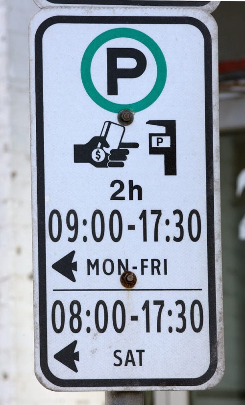 Parking sign on Princess St which denotes the rules for parking/paying for on-street meters- See Kristin Annable story- Jan 14, 2016   (JOE BRYKSA / WINNIPEG FREE PRESS)