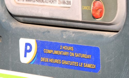 Sticker the Parking Authority puts on meters which denotes complimentary parking on Saturdays on Princess St - See Kristin Annable story- Jan 14, 2016   (JOE BRYKSA / WINNIPEG FREE PRESS)