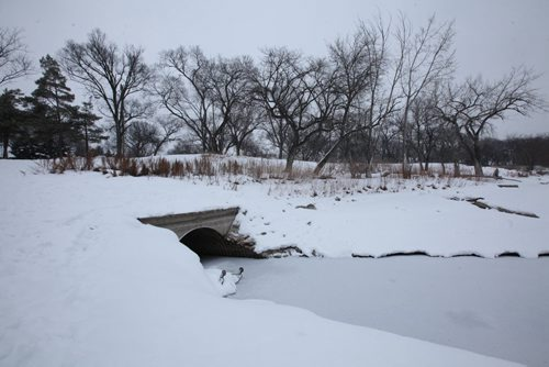 Culvert that opens into the Red River at St. John's Park on Main Street and Mountain Ave. View looking north east. View looking north west.    See story on raw sewage emptying into the river.   Aldo Santin.  Jan 20, 2016 Ruth Bonneville / Winnipeg Free Press