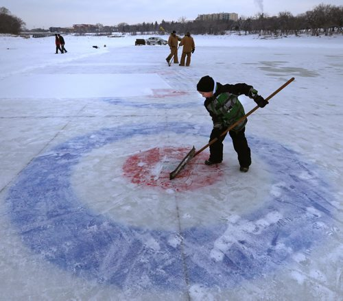 IRONBOY. Colby Henry,8, lends a hand on his day off from school (inservice) cleaning off the snow on one of the 10 curling rinks on the Red River near The Forks for this weekend's Annual Ironman Outdoor Curling Bonspiel. The opening ceremonies are at 4:30 P.M. Friday and through the weekend 80 teams  will enjoy the great outdoors with proceeds going to the Heart and Stroke Foundation of Manitoba.Wayne Glowacki / Winnipeg Free Press Feb.5 2016