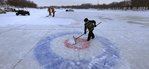 IRONBOY. Colby Henry,8, lends a hand on his day off from school (inservice) cleaning off the snow on one of the 10 curling rinks on the Red River near The Forks for this weekend's Annual Ironman Outdoor Curling Bonspiel. The opening ceremonies are at 4:30 P.M. Friday and action goes through the weekend with 80 teams enjoying the great outdoors with proceeds going to the Heart and Stroke Foundation of Manitoba.Wayne Glowacki / Winnipeg Free Press Feb.5 2016