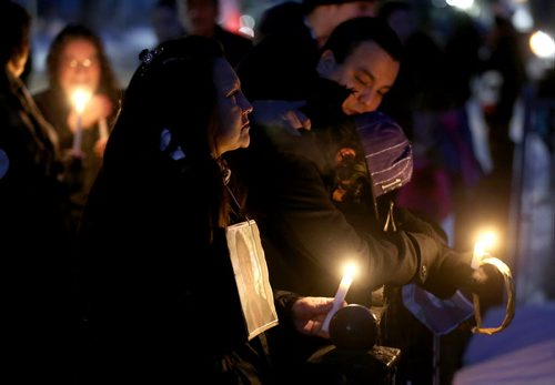 TREVOR HAGAN / WINNIPEG FREE PRESS Friends, family and supporters gather for a vigil in memory of Marilyn Rose Munroe, who was found dead inside her home on Pritchard Avenue earlier this week, Thursday, February 25, 2016.