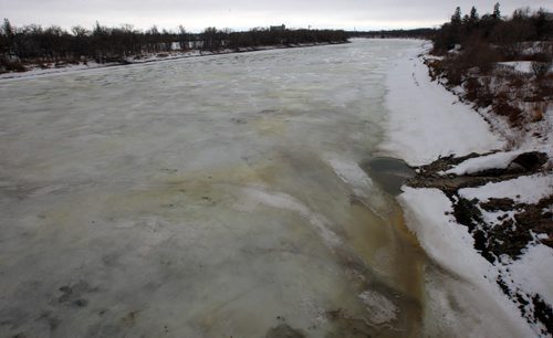 JOE BRYKSA / WINNIPEG FREE PRESS  A few residents who live in the area of the Red River near the St Vital bridge have noticed a yellow ice patches which they say they have never seen before- This view is off the St. Vital bridge looking south  March 08, 2016,(See story)