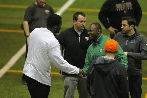BORIS MINKEVICH / WINNIPEG FREE PRESS Bison David Onyemata pro day football workout at the University of Manitoba. Onyemata is the first Manitoba Bisons to hold a pro day football workout.  At least 12-16 NFL scouts and coaches were there. Davis meets a CFL person and a few of the NFL scouts in this photo at the end of the session. Photo taken March 14, 2016
