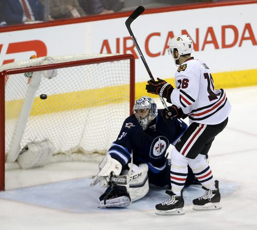 TREVOR HAGAN / WINNIPEG FREE PRESS Chicago Blackhawks' Andrew Ladd (16) scores on Winnipeg Jets' goaltender Ondrej Pavelec (31)during third period NHL hockey action, Friday, March 18, 2016.