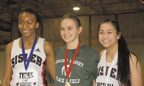 Canstar Community News Victoria Tachinski of Vincent Massey Collegiate (centre) won the senior women's 200 metres in a time of 25.05 seconds at the 2016 High School Series provincial indoor athletics championship on March 17. Brianna Tynes of Sisler High School (left) was second, while Ashley Victoria of Sisler (right) finished third.