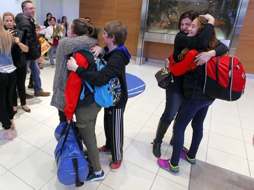 BORIS MINKEVICH / WINNIPEG FREE PRESS Families are happy to see their kids arrive home at James Armstrong Richardson International Airport. Some of the participants on the Winnipeg taekwondo team that arrived at the Brussels airport just minutes after the bombs went off are due back in Winnipeg this afternoon. Photo taken March 24, 2016