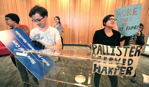 PHIL HOSSACK / WINNIPEG FREE PRESS Sadie-Pheonix Lavoie (right) and other activists waited in vain to confront Brian Pallister about child care issues Thursday. When he didn't show they took over the Conservative leader's podium and sign. See Larry Kusch story. APRIL 7, 2016