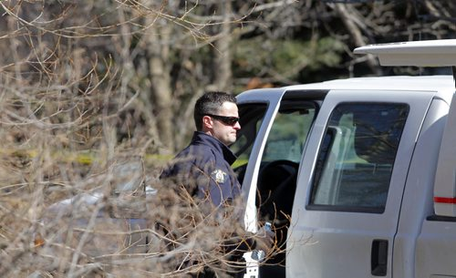BORIS MINKEVICH / WINNIPEG FREE PRESS DAKOTA TIPI FIRST NATION, MB - RCMP are still at locations on the reserve where double shooting occurred early Thursday morning. RCMP on scene of house of shooting victim Chris Pashe. April 8, 2016