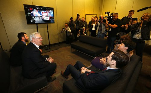 WAYNE GLOWACKI / WINNIPEG FREE PRESS    NDP Leader Greg Selinger with his wife Claudette and sons Eric,at left and Pascal prepare to watch the 2016 election results come in a room next to the NDP 2016 post election gathering Tuesday at the RBC Convention Centre Winnipeg. Kristin Annable  story  April 19  2016