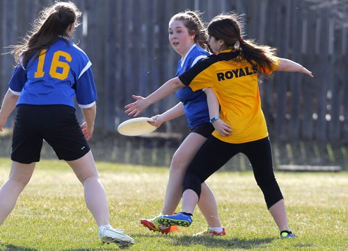 BORIS MINKEVICH / WINNIPEG FREE PRESS J. H. Bruns Bronco Rachel Treffner tries to get thedisc past a Windsor Park Royals in Highschool mixed Ultimate play at Shamrock Park in Southdale. This is the first game for south Winnipeg teams. Broncos lost 8-13 to the Royals. April 26, 2016