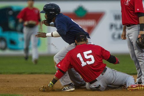 MIKE DEAL / WINNIPEG FREE PRESS Winnipeg Goldeyes' Casio Grider (9) steals second base while Fargo-Moorhead Redhawks first baseman Charlie Valerio tries to catch him in the second inning of the last home exhibition game against Fargo-Moorhead Redhawks Wednesday evening.  160511 - Wednesday, May 11, 2016