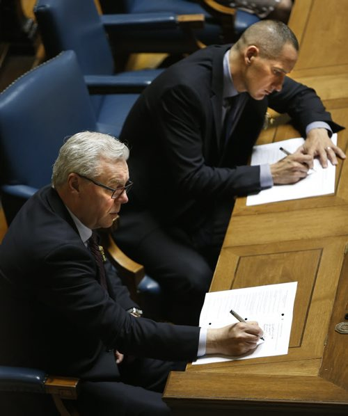 WAYNE GLOWACKI / WINNIPEG FREE PRESS     At left, former Premier Greg Selinger and Kevin Chief take notes in the Manitoba Legislature Monday during  the reading of the Throne Speech. ¤Nick Martin / Kristin Annable  stories May 16  2016
