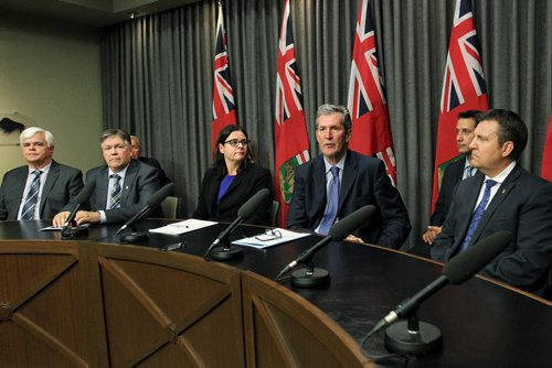 MIKE DEAL / WINNIPEG FREE PRESS  Premier Brian Pallister joined by colleagues in his government and members of Manitoba's business community and aerospace industry is calling on the federal government to ensure that Manitoba's aerospace industry is strengthened not weakened by their decisions at the federal level.   160614 Tuesday, June 14, 2016