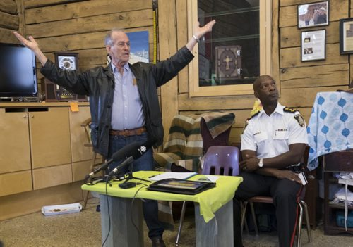 ZACHARY PRONG / WINNIPEG FREE PRESS  Sel Burrows, left, the chair of the North Point Douglas Residents Committee gives a speech at the Barber House in North Point Douglas during an event honouring outgoing Winnipeg Chief of Police Devon Clunis, right, on June 16, 2016.