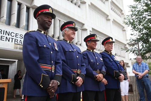 RUTH BONNEVILLE / WINNIPEG FREE PRESS  Winnipeg Police Chief Devon Clunis and past police chiefs, Keith McCaskill (right of Clunis), Jack Ewatski and Herb Stephen, are all smiles at  ceremony to bid Farewell to the old police head quarters on Princess Tuesday.  On July 5th, the doors to the Public Safety Building will officially close for good.    July 05, 2016