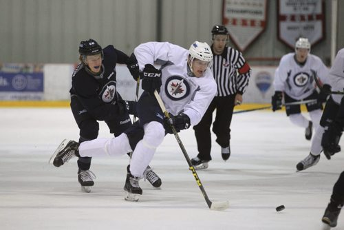 RUTH BONNEVILLE / WINNIPEG FREE PRESS  Matt Ustaski #74 races down the ice with Mason Appleton #82 on his heels in a scrimmage game during the Winnipeg Jets Development Camp at IcePlex Thursday morning.  General action shot of players on ice.   See Tim Campbell story.       July 06, 2016