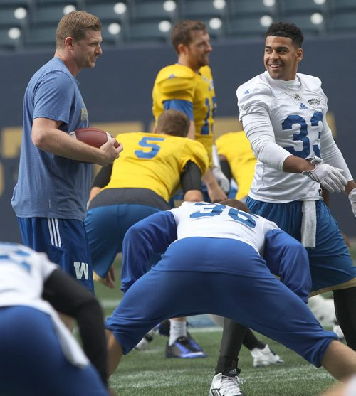 JOE BRYKSA / WINNIPEG FREE PRESS   Winnipeg Blue Bomber head coach  Mike O'Shea, left, has a laugh with Bombers  Andrew Harris  at practice Monday at IGF -The Winnipeg Blue Bombers are in preparation for a home game this Thursday against the Edmonton Eskimos-July 11, 2016  -(See Paul Wiecek story
