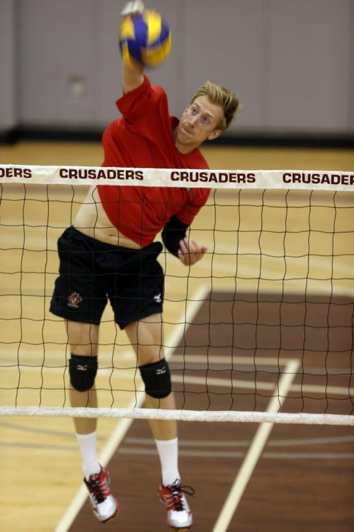 "WAYNE GLOWACKI / WINNIPEG FREE PRESS     Chris Voth, a local professional volleyball player practises his spikes at the net  in the multiplex  at St. Paul's High School.  A European professional¤club withdrew a contract offer recently¤be cause he is gay and the club said they had ""concerns"".   Ashley Prest story  August 10 2016"