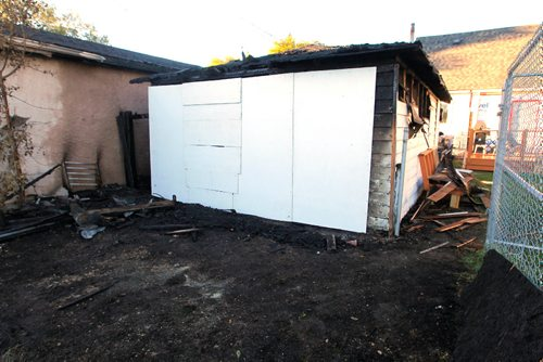 BORIS MINKEVICH / WINNIPEG FREE PRESS BREAKING NEWS - Shots from an overnight fire in the back lane of 635 Harbison Avenue East. It  burned a garage and spread to the property next to it (#639 Harbison Avenue East). It was boarded up in the morning (white boards). Sept. 20, 2016