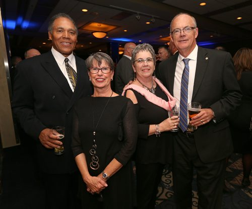 JASON HALSTEAD / WINNIPEG FREE PRESS  L-R: former Bomber defensive lineman John Helton, Nora Helton, Daye Irving and Bob Irving at the Winnipeg Blue Bombers Legacy Gala Dinner at the RBC Convention Centre Winnipeg on Sept. 21, 2016. (See Social Page)