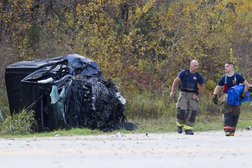 MIKE DEAL / WINNIPEG FREE PRESS A pick up truck sits crumpled at the side of the Garven Road close to where it hit a gravel truck Monday morning. The driver was pronounced dead at the scene. 161003 - Monday, Oct. 03, 2016