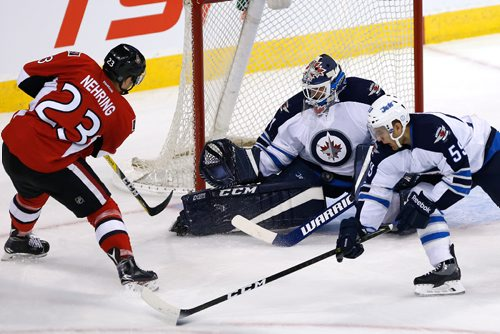 JOHN WOODS / WINNIPEG FREE PRESS Winnipeg Jets goaltender Michael Hutchinson (34) saves the shot by Ottawa Senators' Chad Nehring (23) and Jets' Brendan Kichton (59) during first period pre-season NHL action in Winnipeg on Monday, October 3, 2016.