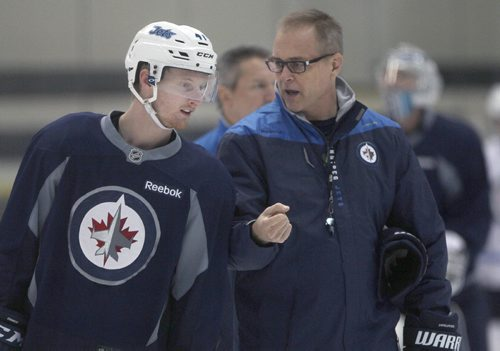 JOE BRYKSA / WINNIPEG FREE PRESSWinnipeg Jets Kyle Connor gets some advice form Jets coach Paul Maurice during a light skate Thursday in Winnipeg. The team less their top line are on their way to Edmonton this afternoon for a pre-season game against the Oilers  . Oct 06, 2016 -(See story)