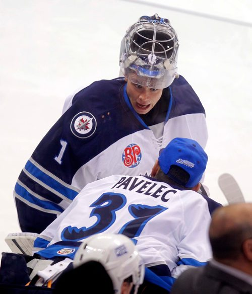 BORIS MINKEVICH / WINNIPEG FREE PRESS Manitoba Moose vs. Bakersfield Condors at MTS Centre, Winnipeg. Moose goalies #1 Eric Comrie, top, chats with #31 Ondrej Pavelec, bottom, during a break in action. Oct. 18, 2016