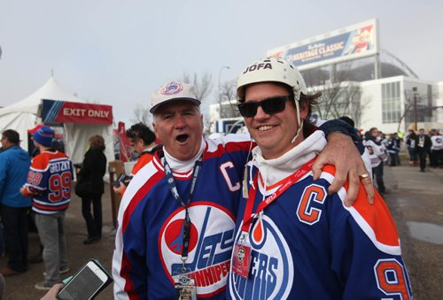 RUTH BONNEVILLE / WINNIPEG FREE PRESS  Marcy Beaucage gives his son Lee a hug prior to the alumni game that Lee bought tickets for him and his dad to attend Saturday.   2016 Tim Hortons NHL Heritage Classic Alumni Game at Investors Group Stadium.   October 22, 2016