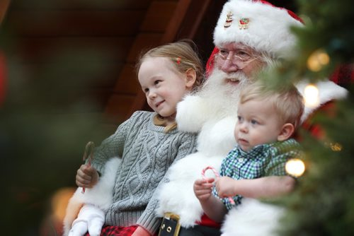 RUTH BONNEVILLE / WINNIPEG FREE PRESS   Four-year-old Aleksa Strzelczyk cozies up with Santa while having her picture taken with her younger brother Maksym (2yrs)  at Polo Park's Santa display Wednesday. Standup   Nov 30, 2016