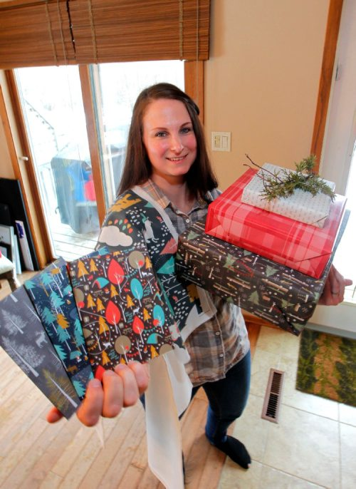 BORIS MINKEVICH / WINNIPEG FREE PRESS Intersection. Leanne Thiessen, owner of Paper Canoe - a paper and fabric design company, creates patterns which she shares on-line and through some exclusive outlets in Manitoba and NW Ontario. Here she poses for a photo with some of her products. Her designs are bought by people around the globe and turned into curtains, clothes, pillows, you name it. She also has her own line of paper products - including Xmas gift wrap. Dave Sanderson story. Dec. 5, 2016
