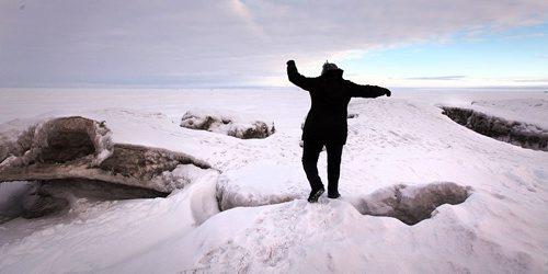 PHIL HOSSACK / WINNIPEG FREE PRESS -  A Winnipeg Beach resident balances carefully on the Windblown ice ridges pile up along the shore at Winnipeg Beach Provincial Park.  ....January 24, 2017