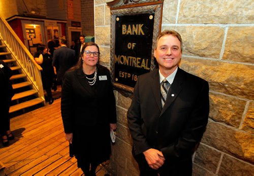BORIS MINKEVICH / WINNIPEG FREE PRESS Announcement of $250,000 from BMO Financial Group's in support of the Manitoba Museum's Bringing Our Stories Forward capital campaign to improve 42% of the Museum Galleries. Executive Director and CEO, Claudette Leclerc, left, and BMO Bank of Montreal Regional Vice President Mike Hassett, right, pose in front of the Bank of Montreal display in the Museum, circa 1817.  Feb. 1, 2017