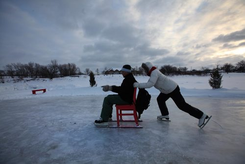 RUTH BONNEVILLE / WINNIPEG FREE PRESS  Betty Thiessen pushes her boyfriend, Chris Evans, on a chair on the River Trail on the Red River later Friday afternoon.  The couple were on a early Valentines Day date taking turns spinning each other around on the ice.   Standup photo  Feb 10, 2017