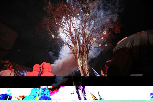 RUTH BONNEVILLE / WINNIPEG FREE PRESS  Hundreds of people crowd around an old elm tree near the fort at the Festival du Voyageur grounds to kickoff the  48th annual winter festival with fireworks Friday evening.   Feb 17, 2017