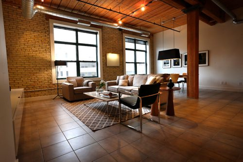 WAYNE GLOWACKI / WINNIPEG FREE PRESS  Homes.  The living room and dining area in the great room in the condo in 181 Bannatyne Avenue (suite 302) in the Exchange District.  The  contact is realtor Sherri Baldwin. Todd Lewys story. Feb. 21  2017