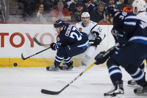 MIKE DEAL / WINNIPEG FREE PRESS Manitoba Moose' Kevin Czuczman (27) takes the puck away from San Antonio Rampage' Rocco Grimaldi (22) in AHL season action at the MTS Centre Sunday afternoon.  170226 - Sunday, February 26, 2017.